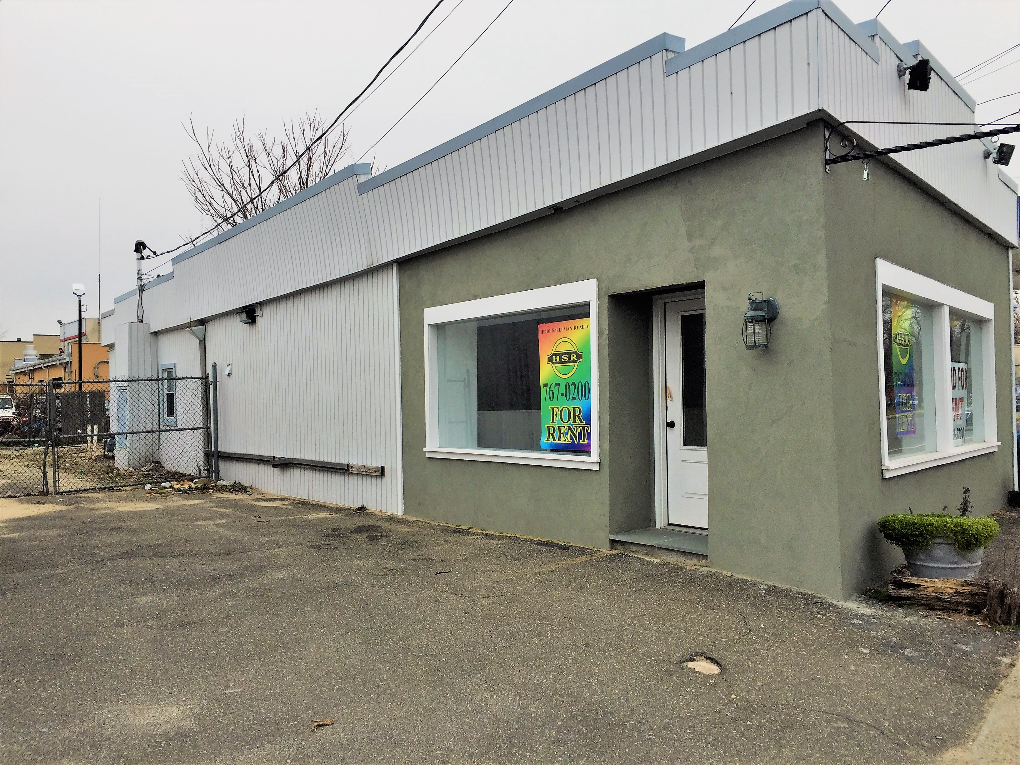 A free standing store front, recently gutted and completely renovated. Awesome space with front 2/3 open floor plan and rear private office space - with built-in shelving - see pictures Amazing exposure to street traffic. Private parking lot in back of building. Storage room. new bathroom and kitchen area. A must see - a dynamite location to bring your business.  Facing 4 lanes of intense traffic flow. Next to a strip center with a Dunkin Donuts, hair salon, laundry mat, perfume store, Pizzeria - Across from a shopping center with Target, HSBC, Rite Aide, movie theatre, GNC, Ace Hardware and more. Cars traveling to 2 elementary schools, Manorhaven Beach Park, and Sands Point all must pass this location. There is a private fenced parking lot for 6-8 cars - A must see to appreciate
