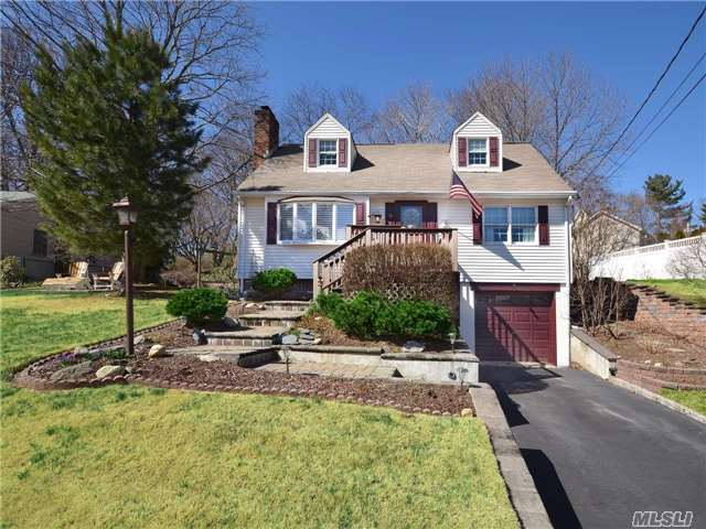 Privately Yours..From The Lushly Landscaped Private Yard, To The Spacious Rooms, This Home Is Elegantly Appointed For Entertaining.Set On Oversized Grounds, This Beautifully Updated 3 Br, 2 Bath Cape Cod Features A Fdr W/Sliders To The Huge Backyard, A Newly Updated Finished Basement Offering A Family Rm, Home Exercise Rm, & Laundry Area. North Shore Schls, Beach Privileges