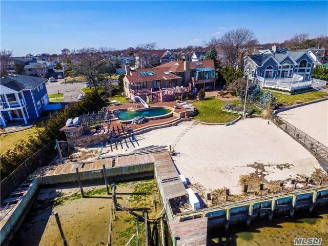 Location ! Location! Huge Split- Level Home On Open Bay & Cul-De-Sac In Massapequa's Harbor Green Estates. 4 Bedroom, 3 Bathroom, 3 Car Garage, Gunite Pool, Cabana, Trex Decking, Gorgeous Views, Private Beach. Being Sold As-Is. One Of A Kind Waterfront Estate