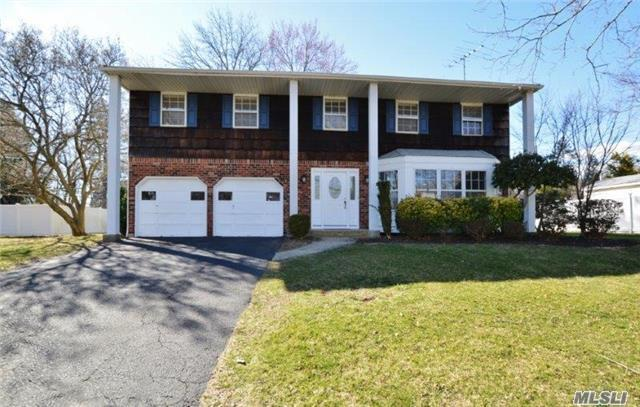 Beautiful Large Colonial With Updated Kitchen And Baths. Gleaming Hardwood Floors Throughout. Cul-De-Sac.