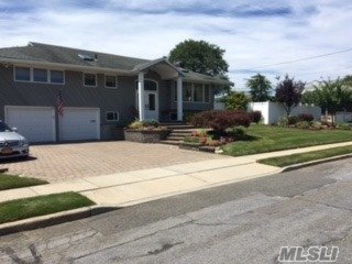 Welcome To This Beautiful Hi Ranch In Desirable Old Bethpage. Unique Main Level Den Opens To Updated Kitchen W/Granite And Stainless Appl's, Gorgeous Baths, Wood Floors, Gas Heat/Cooking, New Cac, 9 Zone Igs, Fpl, 2 Car Garage, 3 Car Brick Driveway...Stunning Country Club Backyard With Igp/Waterfall With Separate Large Grass Area, , , Must See!!