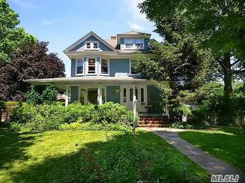 Embraced By A Large Wrap-Around Porch, This 3 Story Victorian Sits On An Oversized Lot. It Features Beautiful Moldings, 9' Ceilings, High-End Appliances, Custom Oak Cabinets, Updated Bathrooms, Updated Gas Boiler, 2 Car Detached Garage With New Doors And Openers, Large Fenced Back Yard With Ornamental Fruit Trees, Updated Roof, Double Pane Vinyl Windows, & Insulation...