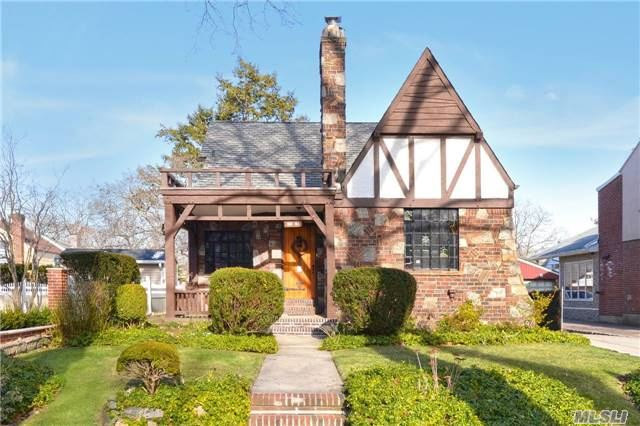 Beautiful Charming Tudor In The Heart Of Jamaica Estates. Character Throughout, Breath Taking Vaulted Ceilings With Exposed Beams In Living Room W/Frpl. Formal Dining Room, Oak Eik W/Granite Counters, 4 Large Bedrooms, Huge Basement With High Ceilings, Wine Room, Additional Space For Office/Gym. Lovely Backyard, Located 2 Blocks From, St. Johns University, Shopping, Etc!