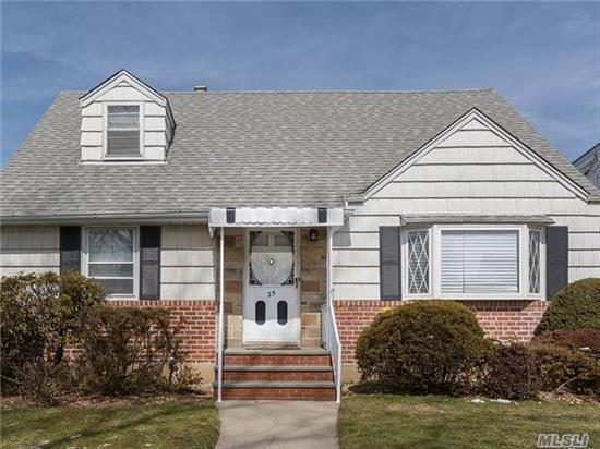 Rare Expanded Cape On 50X100 Lot In Herricks School District. Hardwood Floors On First Floor, Huge Family Room Off The Kitchen And Kitchen With Breakfast Bar And Two Bedrooms Plus Full Bathroom. Upstairs Features 2 Full Bedrooms Plus Office/Nursery, And A Second Full Bath. Gas Heat. Private Back Yard With Detached Garage.