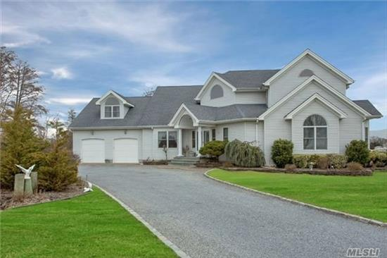 Beautiful 4700 Sq Ft Waterfrt Colonial Tucked Away On Private Rd Sits Perfectly Positioned For Spectacular Views Of Grt So Bay & Bridges. Dramatic 2 Story Entry Leads To Walls Of Glass Looking Out Over Great Cove. Open Flr Plan, 1st Fl Master, Heavy 2X6 Construction W/Steel Beams & 52 Pilings, Stairs To Dry Crawl, Great Elev, Boat Slip W/Water & Elec, Low Flood Ins, Islip Schs.