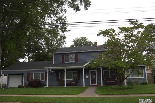 This Sprawling Colonial On Oversized Lot Is Located On A Quiet Prime Massapequa Park Village Residential Block And Conveniently Located To All Features Open Floor Plan, Large Living Room With Wood Burning Stove And Sliders To Covered Deck Overlooking Park Like Grounds, Family Room, Large Master Bedroom With Vaulted Ceiling, Updated Baths, 2 Wide Dining With 1.5 Garage