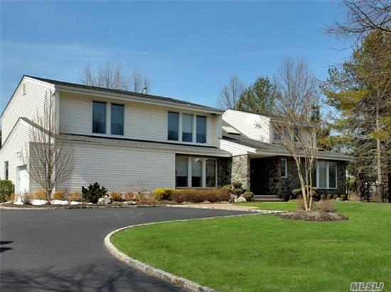 Dix Hills Post Modern Colonial Totally Renovated With Fine Quality! ! Incredible Value For Like New Home! Viking Appliances, Finest Custom Baths, Wood Floors Moldings, Open Floor Plan Volume Ceilings. Full Finished Basement With Quality Large Entertainment Area 2 Guest Rooms Summer Kitchen 2 Baths! Flat Private Acre On Quiet Double Culdesac Of Young Homes.