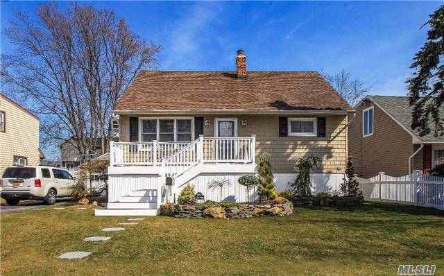 Stunning Cape Loctd In Wantagh's Mandalay Neighbrhd. This Fully Renovated Hm Offers Beautfl Updates, Finishes & Moldings, A Great Open Pln & Gorgeous Red Oak H/W Flrs. This Elevated Home Features A Young Ss Kitchn W/ Island & New Bath, Trex Deck & Patio, Fully Fenced. Conv Loctn To Wantagh Park, Parkways & All. Flood Insur $495/Yr, Assumable. Low Taxes; $10, 795 Aft Star.