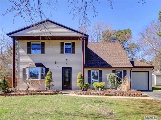 Beautiful Center Hall Colonial,  New EIK Kitchen With Granite Counter Tops and all new appliances, Large Formal Dining Room,  Large LR,  Den with New sliding doors,  4 Bedrooms,  2.5 Bath. New Roof In 2014 With Warranty. New backyard pavers. Taxes with basic star only $9214.82. Comsewogue SD