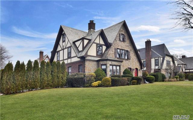 This Charming Stately English Tudor Is Located In The Desirable Estates Section. Updated Kitchen, Ss Appl, Sunken Lr W/ Fpl, Formal Dr, Full Bath, Mudroom W/ Washer & Dryer, Large Walk-In Pantry Closet, Screened-In Porch. Large Master Suite, 3 Large Bedrooms, Full Hall Bath. Full Walk-Up Attic & Finished Basement W/ High Ceilings. Close To Schools, Parks, & Lirr. Must See!