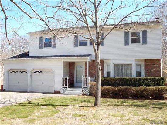 Fabulous 4 Bedroom, 2.5 Bath Colonial-Featuring-2 Zone Cac, 2 Zone Heat,  Hardwood Flooring, Family Room With Brick Fireplace And Sliders Opening To A Large Sunroom, Full Basement, 2 Car Garage & More. Property Backs To County Of Suffolk Owned Land Resulting In A Very Private & Pristine Setting. Conveniently Located Near All Shopping And East End Amenities.