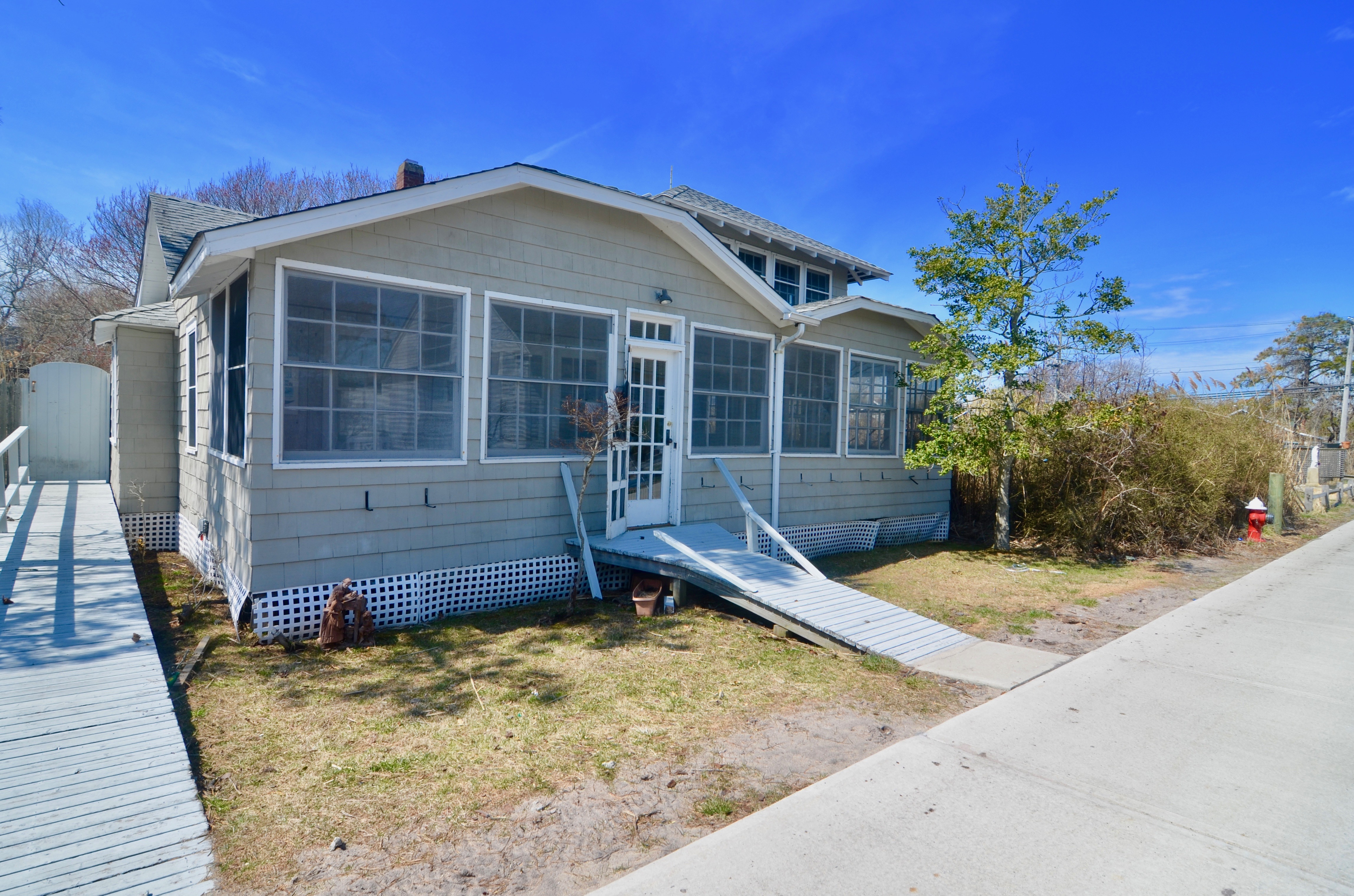 """<a href=/""""http://www.a2vh.com/Unit/Details/133379"""">For real time availability and online booking click here </a>  Classic Fire Island Cottage on ocean block. Charming home with 4 bedrooms, 1 full bath, 2 half baths and outdoor shower. Bright and airy space with large living and dining area that leads onto the enclosed front porch. Enclosed back porch with a half bath. Laundry inside off of kitchen. 3 bedrooms downstairs with a full bathroom. Master retreat upstairs with a half bath. Spacious East facing back deck with out door shower. This house is 2 minutes from the beach and 2 minutes to town.  July- $14,000 August- $16,000 Memorial Day to Labor Day- $32,000"""