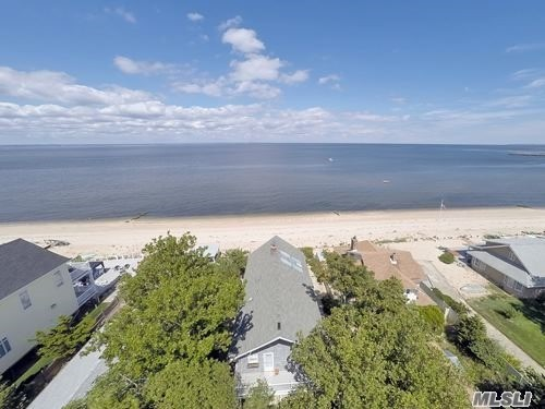 Come Relax In This Beautiful Beachfront Hi-Ranch. Breathtaking Panoramic Views Of Li Sound & Connecticut. Cozy Up Yr Round To A 3-Way Fireplace As You Gaze Out Picturesque Windows.Open Floor Plan, 4 Br / 3 Bath, Master Br W/ Full Bath & Balcony. Sliding Doors From Dr & Lr Open On Deck-Great For Outside Entertaining!Porcelain Patio Off Family Rm Opens Onto 50Ft Of Pvt Beach