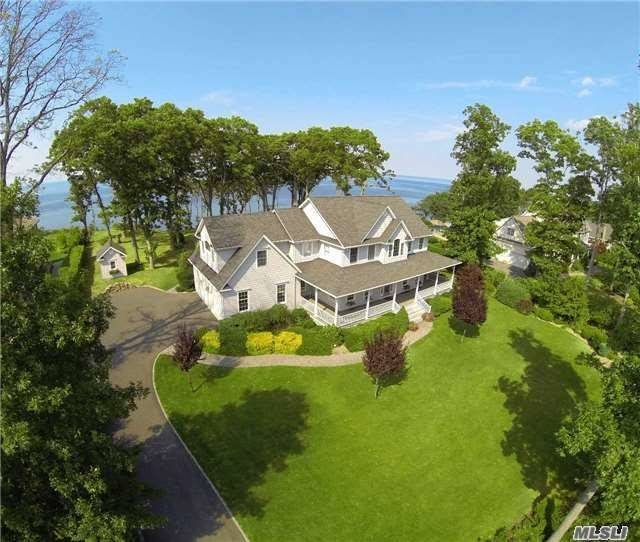 Soundfront Post Modern With Inground Pool On The Waterside, Path To Beach. Master Bedroom With Balcony Overlooking The Li Sound And Elegant Master Bath. 9' Ceilings, Hardwood Floors, 4 Bedrooms Total And 3.5 Baths. An Ideal Retreat For Your North Fork Getaway. Park-Like 1.7 Acre Property Established Gardens Offers Privacy Enjoy 151 Ft. Of Pristine Beach. Glorious Sunsets!!
