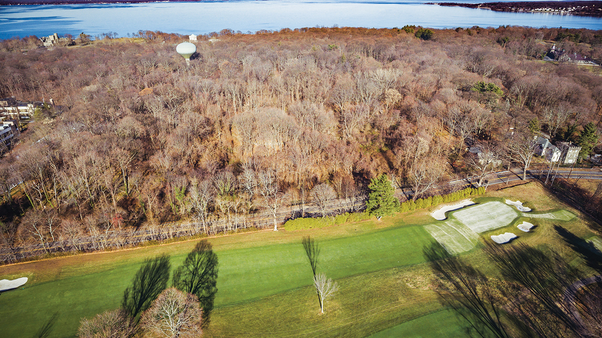Drastically reduced will not last at this price!! Formally owned by the US Navy, used as a lookout in WWII for German submarines.  Facing East, a level 5-acre parcel sloping towards the water.  Next to the entrance of the Sands Point Preserve  across from the Sands Point, Private Membership, Golf Club.