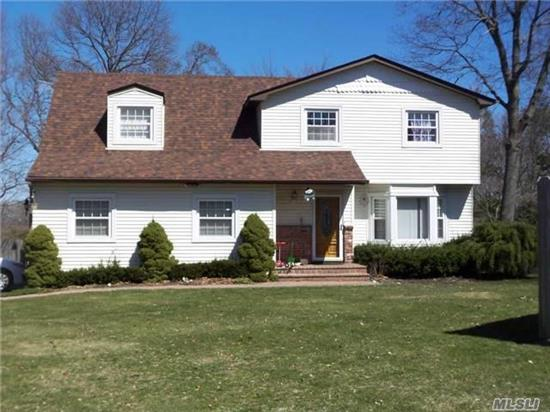 Colonial On A Very Private Shy 3/4 Acre Lot. Bellecrest Area. Featuring Four Bedrooms And 2.5 Bathrooms, Large Family Room With Fireplace. Sliders To Large Deck, Newer Roof, Windows,  Vinyl Siding, Appliances. Taxes Can Be Grieved.