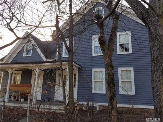 Legal 2 Family Both With Front Entrance,  1 Side W/1 Bedroom & 1 Bath; The Other Side W/3 Beds & 1 Bath. Detached 2 Car Garage,  1/2 Acre Property,  Walk To Town, close to LIRR.