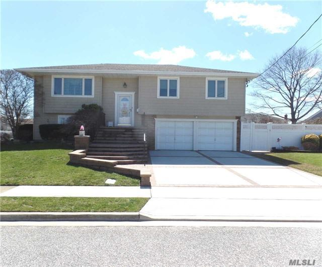 Expanded Hi Ranch In Massapequa Shores. Great Curb Appeal. New Paver Walk & Stoop. Pvc Fenced. 2 Car Att Garage. Ent Foyer, Lr, Fdr, Eik & Extension W/Composite Flrs, Mbrm With 1/2 Bath, 2 Addt'l Bdrms & Full Bath. Lower Level Fam Rm, Lg Bdrm, Full Bath, Laundry, 5th Bdrm/Home Office. Igs, Cvac, Close To Florence Beach. Flood Zone X -No Flood Insurance Required By Fema