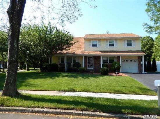 Lovely And Well Maintained Charter Oaks C/H Colonial With Pride Of Ownership Throughout. Newer Roof, Siding Windows Fence Kitchen & Bths. Bring Your Imagination For Decorating And Updating! Great Bones.. Sewers, Sidewalks Are A Great Bonus!!! Close Proximity To Beach, Golf, Boating, Lirr And So Much More. Taxes Do Not Reflct Star Of $994.91...