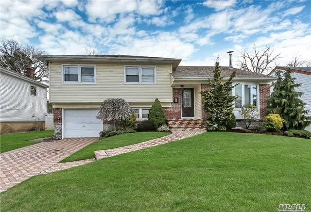 Mint 3 Bdrm 2 1/2 Bath Updated Mid-Block Split Close To The Harbor! Entry Foyer, Living Rm W/Woodburning Stove, Formal Dining Room, Granite/Stainless Eik, Updated Roof, Windows, 200 Amp Electric, Pella Doors, 5 Year Walk-Way, Driveway. Beautifully Landscaped. Won't Last!!