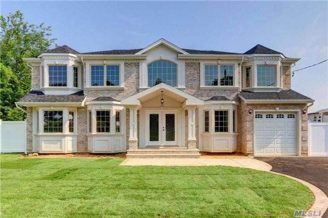 One Of A Kind 3100 Sq.Ft. Brick Colonial W/High End Quality Throughout! Elegant Ent Foyer/Huge Custom Eikw/Quartz Island/48 Fisher & Paykel Stove/Double Sided Gas Fireplace In Living Room & Den/Pella Windows & Sliders/Grand Master En Suite W/Dream Closet & Marble Tle Bath/Gas Heat/Cac/Crown & Recessed Pic Molding & More! See Attachment. Pics Show House 90% Finished!