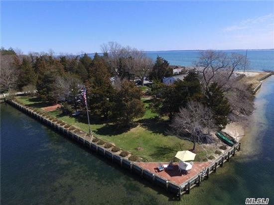 Idyllic Waterfront Property On 3/4+ Acres,  Private Community White Sand Beach. Charming Main House Has 4 Bdrm, 2 1/2 Baths, Den. Adorable Legal Guest Cottage W/2 Bdrm, 1 Bath. Both Houses Have Waterfront Decks And Waterviews (Main House On 3 Sides) Deeded View Of Peconic Bay. 270' Private Bulkhead, 462' White Sand Hoa Beach. Landscaped. Perfect For Boat Owner Must See!