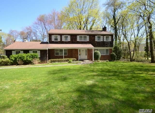 Classic 4 Bedroom, 2.5 Bath Colonial Nestled In The Woods. Ef, Fdr, Lr W/Fpl, Den, Eik W/Sliders To Deck, Mud Rm W/W/D, .5 Bath. 2nd Floor; Mstr Ste W/Dressing Area & Full Bath, 3 Addt Bdrms & Full Bath. Full Unfinished Bsmnt W/Ose. 2 Car Attached Garage. Wonderful Opportunity To Make It Your Own.