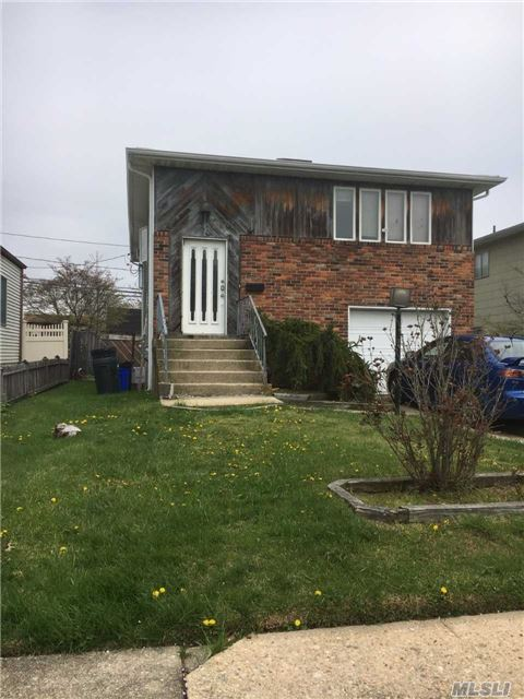 Possible M/D, Large Newer Kitchen, Wood Floors In Lr, Fireplace In Den, Close To Beach. House Has Tons Of Possibilities!!!!!