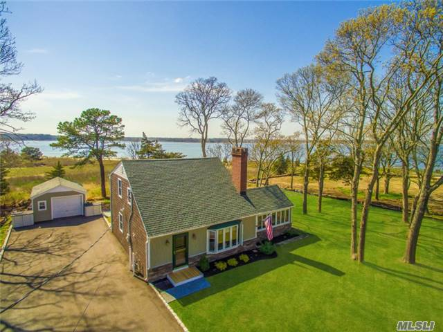 This Completely Renovated 3 Bedroom, 2 Bathroom Cape With Sweeping Bay Views Leaves No Stone Unturned. Features Include Two Fireplaces, One Wood, The Other Gas, Radiant Heated Floors, New Windows, Roof, Furnace, Trex Deck And Awning. Beautiful Water Views From Almost Every Room In The Home. Enjoy Stunning Sunsets From The Rear Deck Of Your Own Private Sanctuary!