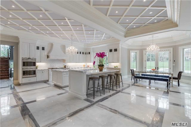A Must See Transitional Style New Construction Home!  8455 Sq. Ft Boasts Ultra-Chic Interiors Highlighted By Versatile Floor Plan Flowing Easily From One Generously Sized Room To The Next, Finished To The Highest Standard. Custom Plaster Ceilings, Moldings, Boiserie, Ultimate Kitchen/2 Islands/Crystal Chandeliers, Library, Elevator,  Flat Acre/Pool/2 Much 2 Describe!