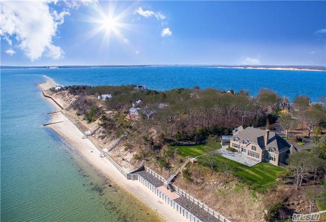 Eastwind A Gracious Brick Nassau Point Bayfront Home Designed By Samuels & Steelman On Two Private Acres Of Richly Landscaped Land, With 200 Feet Of Sandy Beach And New State Of The Art Double Bulk Heading. Quality Materials And Craftsmanship Throughout The 7000 Sf Of Living Space Bathed In Sunlight With Spectacular Water Views Of Peconic Bay From Every Angle.