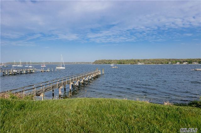 Beautiful 3.3 Acre Waterfront Colonial With Dock. House Has Tons Of Room And Potential To Make Your Very Own. Five Large Bedrooms And 4.5 Baths. Gently Rolling Property With A Pool Over Looking The Sound With Pretty Views Of Cove Neck. Enjoy A Large Brick Patio Overlooking The Water With A Pond With A Waterfall.