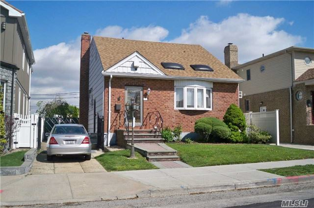 Beautiful 4 Bedroom Brick Colonial With Skylights, 2 Full Bathrooms, 1 Half Bathroom, Wood Floors, Granite Title, Kitchen With Formal Dining Room, Master Bedroom Is A 2 Bedroom Being Used As A One, Huge Full Finished Basement With A Bar And A Gorgeously Brick Paved Backyard.