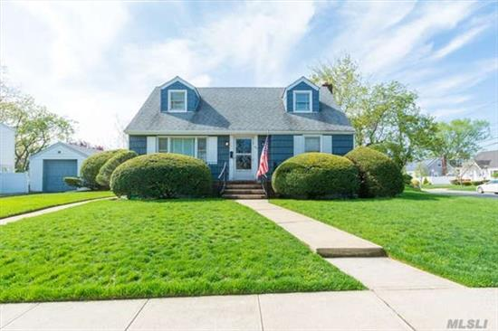 Well Maintained Cape In Oceanside School District. Private Yard, Professional Landscaping. Wont Last!!