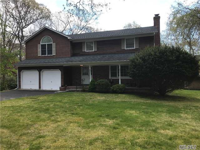 A Rare Opportunity To Own This 4Br 3 Bath Colonial On Park Like 1/2 Acre W/Low Taxes. Home Boasts Fdr, An Amazing Family Room Perfect For Entertaining . Lr, W/Fpl, Eik, Additional 26X30 Bonus Rm Above Garage. Wood Floors Through Out, New Roof, Updated Utilities, Just Minutes From Beautiful Beaches, Shopping And Restaurants