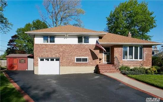 Tax Reduction Of 25% Will Be Reflected In Oct. 2017.  This Spacious Open Floor Plan Split With Vaulted Ceilings Includes A Contemporary Updated Kitchen With Maple Cabinets & Glass Tile Back Splash, Newly Refinished Wood Floors, Updated Bathrooms, Roof, Boiler & Hot Water Heater.Sliding Doors From The Dining Area Lead To A Large Deck Overlooking The Expansive & Fenced Yard.