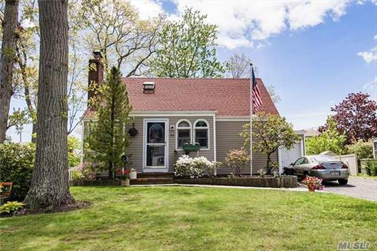 Lovely 3 Bed, 2 Bath Cape Home In Massapequa Woods, Living Room W/Fireplace, Updated Kitchen W/ Ss Appliances, Hardwood Floors Throughout, Gas Heat & Hot Water, Cac, Attached Garage, Double Wide Driveway, 150 Amp Electric, Anderson Windows