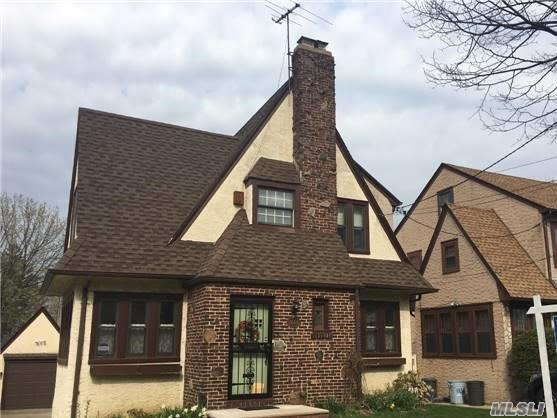 Beautiful Detached One Family Tudor - First Floor - Living Room With Wood Burning Fireplace - Modern Eat In Kitchen, Formal Dining Room. Second Floor - Three Bedrooms & New Full Bath. Full Newly Finished Basement With Half Bath & Laundry Room. One Car Detached Garage & Driveway. Close To All Transportation & Shopping.