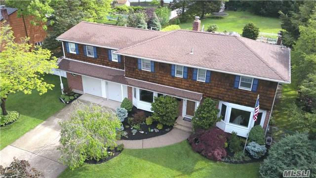 Beautifully Appointed Colonial Offers Generously Proportioned Living Areas, Features Include Custom Moldings, Wood Flooring Throughout, Kitchen W/Breakfast Bar, Den W/Fireplace, Newer Baths, Dramatic Master Suite, Cedar Closets,  Sun Room With Timber Tec Flooring, 2.5 Garage, 16X32 In-Ground -Pool With Cedar Decking, Professionally Landscaped Property & Much More!