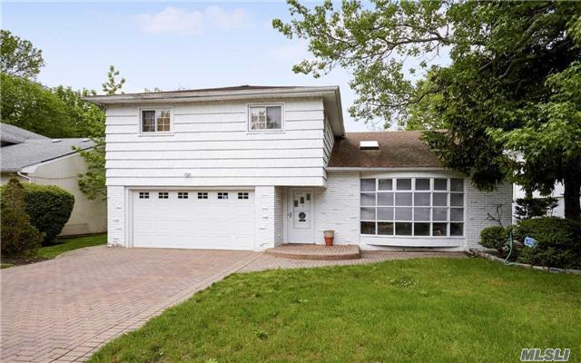 In The Heart Of Hewlett . 4 Bedroom Spilt With 2.5 Bathrooms. Living Room With Cathedral Ceilings.Eat In Kitchen. Formal Dining Room. Spacious Den With Sliding Glass Door To Backyard. Basement With A Playroom And Plenty Of Storage.