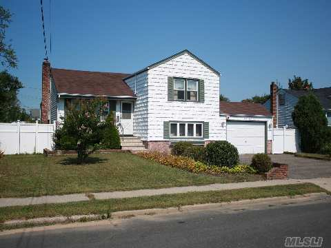Spacious 4 Br Split, 2 Full Baths, Eik, Formal Lr & Dr. Basement With Ose, Updated Windows, Igs, Cvs, Updated Front Entry Way, Hardwood Floors Throughout.Taxes With Basic Star $9,119