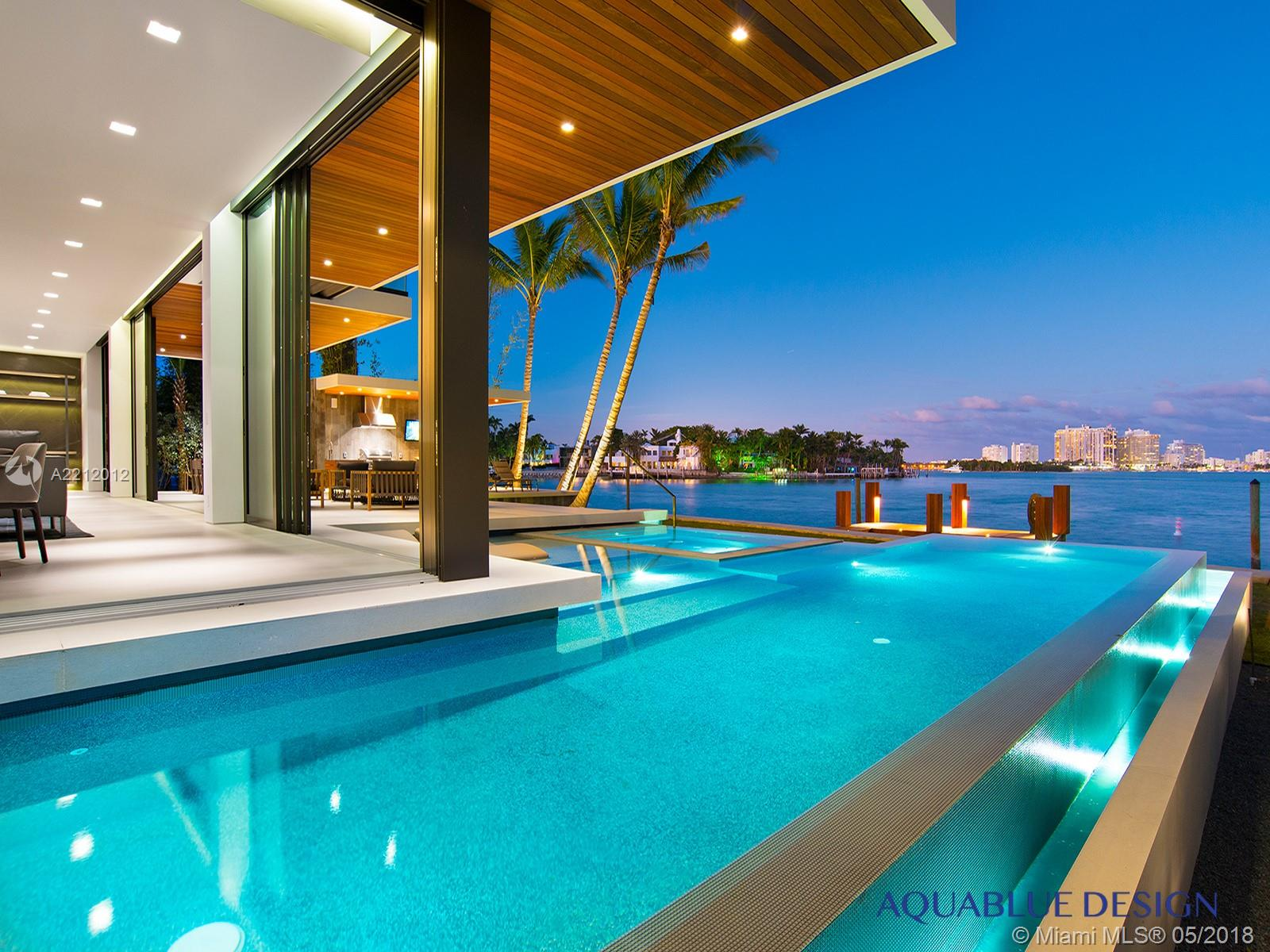 Contemporary Miami Beach Luxury Waterfront Home By The Aquablue Group. 10, 050 Square Feet Of Open Plan Living Spaces With Idyllic Transitions To Expansive Outdoor Living Areas. Overlooks 110 Feet Of Waterfront Views Of South Beach. Floor To Ceiling Rear Sliding Doors, Infinity-Edge Pool And Spa, Custom Italian Kitchen And Closets, Elevator To Rooftop Terrace, Fully Automated Home With Crestron System. Luxury Italian Furniture Included. Completed January, 2018.