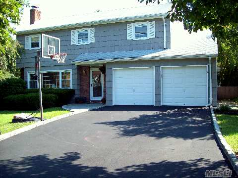 Fabulous 4 Bdrm Colonial With Finished Basement. Wonderful Location And Property.  Freshly Painted Inside & Out, Updated,Staged And Designed To Sell.  Pride Of Ownership Through Out Turn Key Move In And Unpack And Enjoy.  Blue Ribbon Commack Schools!