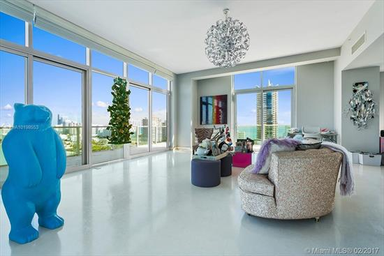 Incredible Contemporary 2-Story Loft Ph With 12 Ceilings, Roof Terrace With Ocean, Intracoastal, Golf, And City Views, Boasting Over 5, 000 Sf Total Living Space. Sunrises To Provide Soothing Natural Light & Nighttime Views That Give A Performance Of Twinkling Activity & Life. Oversized Rooms, Marble Tile Throughout, Bulthaup Cabinetry, Sub-Zero & Gaggenau Appliances, Wraparound Balcony And Massive Rooftop Terrace. Gated Private Island, With 24 Hour Security.