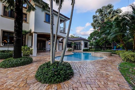 Magnificent 2007 Hollub Built Northeast Pinecrest Mediterranean Beauty<Br />Nestled On A Quiet Street. Very Special Appointments & Details Galore<Br />Including Gourmet Chef'S Kitchen, Movie Theater, Gym, Office, <Br />Basketball Court, 6-Car Garage-Motor Court-Parking Pavillion, &<Br />Generator. 2-Story W/Huge Downstairs Master Bedroom, Playroom, &<Br />Separate Kids Family Room Too. This Home Is Set On A Gorgeous Oak<Br />Laden Acre W/Superb Curb Appeal, Floor Plan & Finishes. Seller'S Disclosure & Floor Plan Attached.