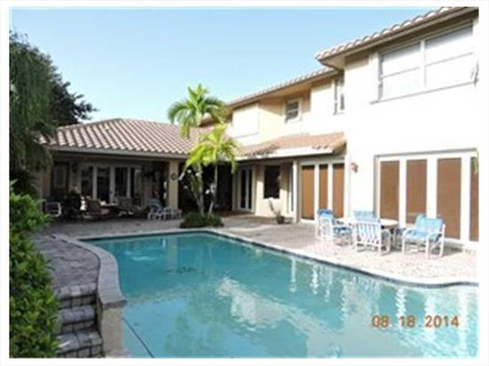 Custom Courtyard Home In Enclave. 5 Bedrooms, 4.5 Baths, Including Separate Suit For Maid Or Inlaws. Panoramic Views Of Lake, Open Patio And Pool.