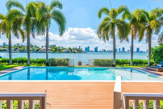 Stunning Modern Newly Renovated 5 Bed, 5 1/2 Bath Home With Tropical Design Influence On Venetian Islands With Tranquil Westerly Views Of Biscayne Bay. Serene Courtyard Entrance And Ipe Details Surrounding The Home. Gourmet Kitchen, Top Of The Line Finishings, Wood Floors In Living Areas, Open Plan Family And Dining. Large Covered Exterior Entertainment Patio With Poolside Bbq. A Smart Home For Luxury Living. 80 Feet On Water With West Sunset Views.