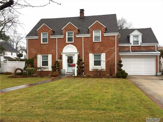 This Is A Beautiful Center Hall Colonial On A Large Lot. It Has An Eik W/ Brf Nook, Fdr & Lr Each W/ Spectacular Built-Ins, Lr Also Has Wood-Burning Fp, Mbr W/ Ensuite + 3 Large Bdrs, Finished Basement W/ High Ceilings And Recessed Lighting, & Another Wood-Burning Fp, A Sunroom, Patio, Over-Sized Backyard, 1.5 Garage W/ Pvt Driveway That Will Fit 3 Cars.