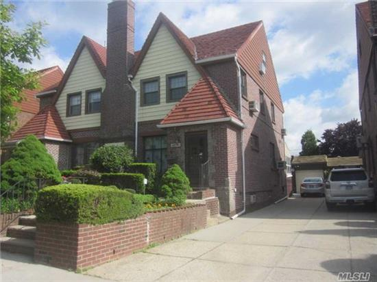 Semi Det Solid Brick Tudor, 4 Bedrooms, 11/2 Baths, Private Yard And 4 Car Driveway. Close To All Transportation, Shops And House Of Worship