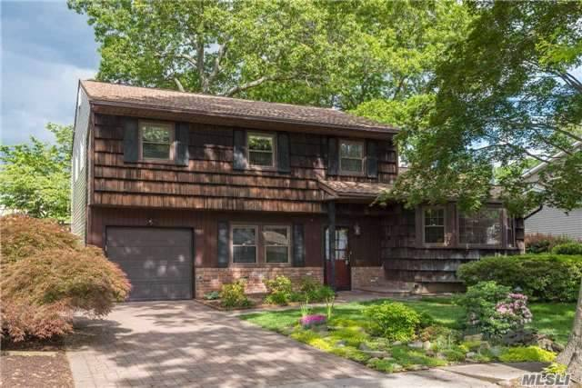 Look No Further! Spacious 4-Bd, 2.5-Bth Splanch In A Great Dix Hills Neighborhood! Gleaming Cherry & Oak Flrs. Updated Maple/Corian/Stainless Steel Eat-In Kitchen. Other Updates Incl Windows, Cac, Doors, Roof, Paver Walk/Driveway, Alarm, Igs, 200-Amp. Family Rm W/Fpl & Sliders To Yard. Mstr Bdrm W/Full Bth. Inviting Screened-In Patio. Beautiful Gardens. Be The Proud Owners!